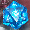 Multi faceted blue glass paperweight