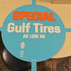 Gulf N.O.S. tin tire display sign