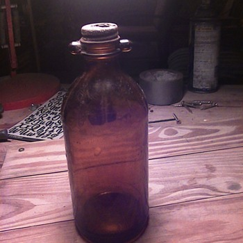 Odd Amber duraglas bottle with some kind of handles