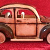 Hand crafted Wooden Volkswagen Beetle with Rolling Wheels