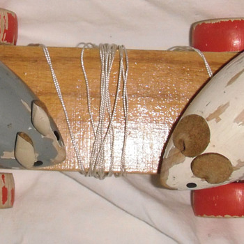 Mice move as you pull toy how old & from which co or hand made? - Animals
