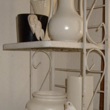 Cumi camoflage on my white pottery rack and some other bird stuff - Art Pottery
