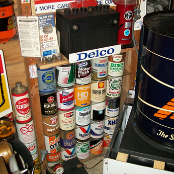 Delco battery display and oil cans - Petroliana