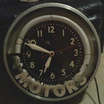 CLOCK MADE BY MODERN CLOCK ADV COMPANY