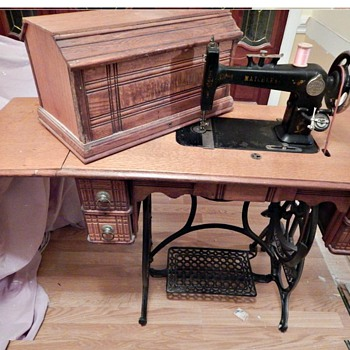 Matchless treadle sewing machine with cabinet