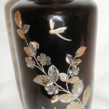 Black vase painted with Gold, Silver & Copper Design
