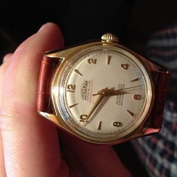 VINTAGE 18 KT. GOLD SWISS WATCH - Wristwatches