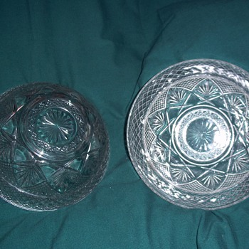 2 identical bowls but different numbers on the bottom. Crystal or glass??