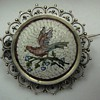 Micro Mosaic Brooch depicting a bird on a branch set in silver.