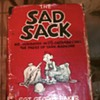 Sad Sack, Sarge Snorkel, Beetle Bailey comics and a Hard Copy.