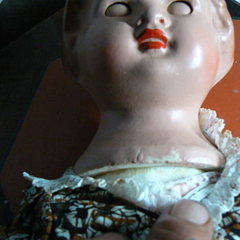 old porcelain doll with porcelain sleepy eyes and soft body