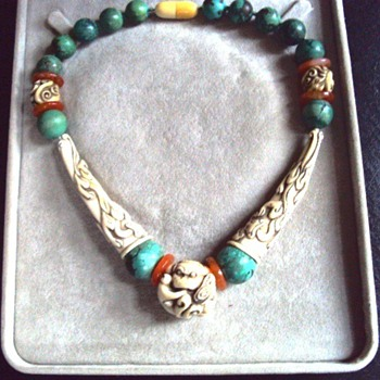 Where is this ivory, turquoise and carnelian necklace from?