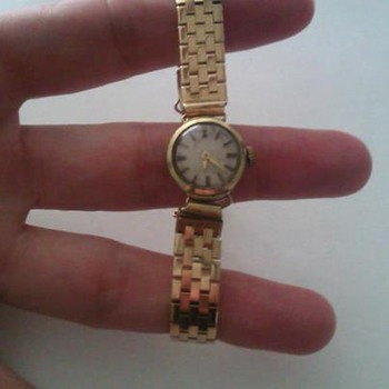 14 karat from Grandma (she got it in 1943) I believe it is a doxa..