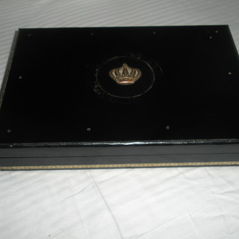 BLACK WITH CROWN EMBLEM JEWELRY BOX. ANY IDEA BY WHO?