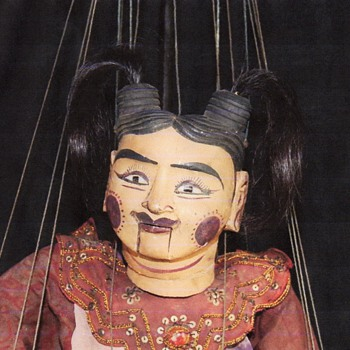 I need someone who can restring my wooden puppet.