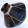 Old large pottery w/ rawhide wrap