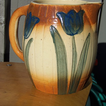 Old Pottery Pitcher with Barrel and Tulip Decor ? Need help identifying.