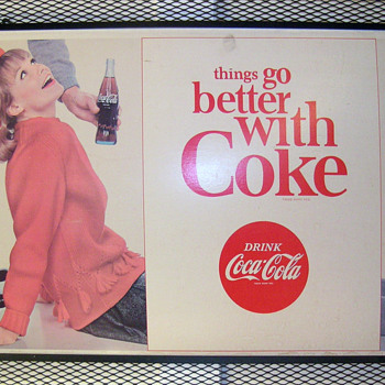 Large Coke sign.  - Advertising