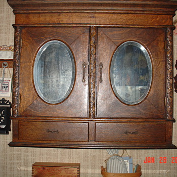 Antique Oak Two Door Cabinet...Beveled Oval Mirrors...Two Drawers With Key - Furniture