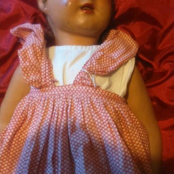 I found this doll in a junk shop - she is paper mache and wood , about 2 foot tall and a walking/talking doll .