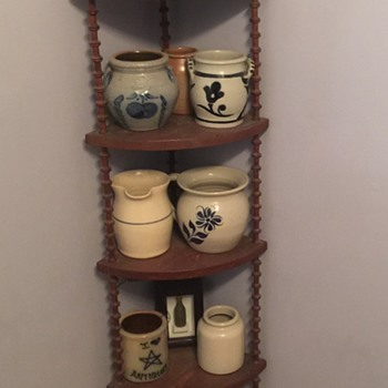 Various pottery and wooden spool shelf
