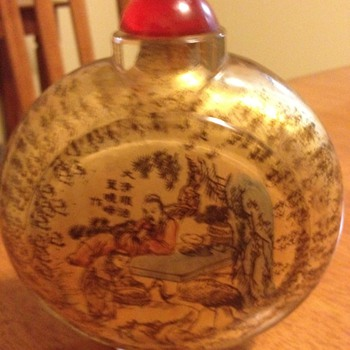 snuff bottle has picture and chinese or japanese writing on it very interesting want to know more about it please