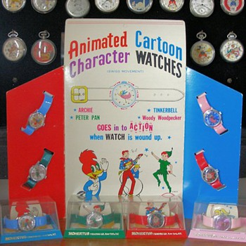 1969 Rouan/Mohertus Store Display & Boxed Archie, Peter Pan, Tinkerbell, & Woody Woodpecker Watches - Wristwatches