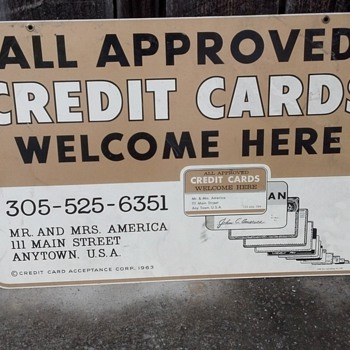 metal credit card sign