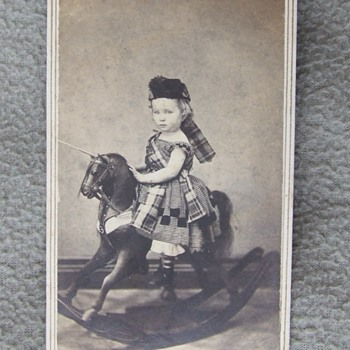 Boy in dress on a rocking horse!