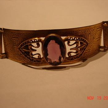 Gold Bracelet With Swastika And Large Rhinestone