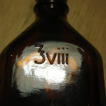 OLD BROWN BOTTLE with WEIRD MARKINGS.