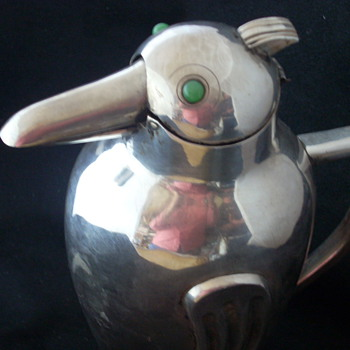 Sterling Silver pitcher, shape of bird, beak moves