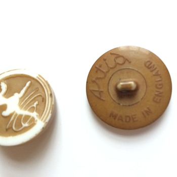 Any info or help to identify these buttons?... - Sewing