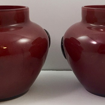 Pair of Oxblood Tango Glass Vases with Black Prunts, ca. 1920s, maker unknown