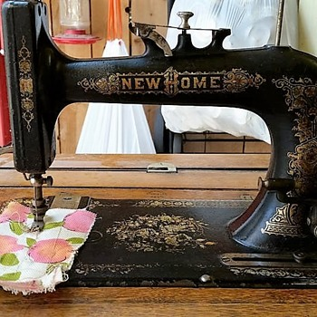 1908 New Home Treadle in a beautiful Parlor Cabinet