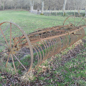 Old farm equipment, a trailing hay rake from Blackstone & Co