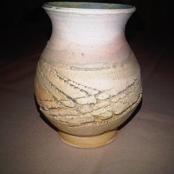 Stoneware vase with rough exterior yet glazed internally. Signed WH Help needed!