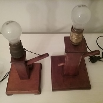 Two old wooden lamps in water pump design