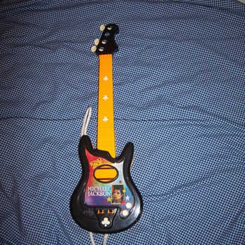 Michael Jackson toy guitar - Music Memorabilia