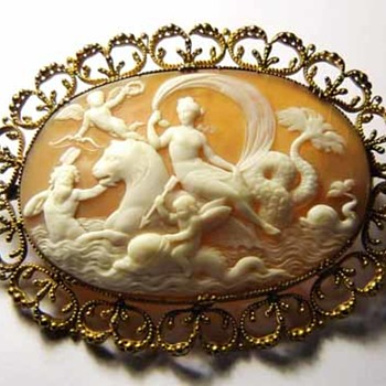 Cameo of cherubs with dolphins