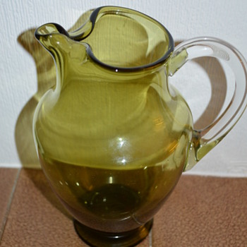 Big olive coloured glass jug
