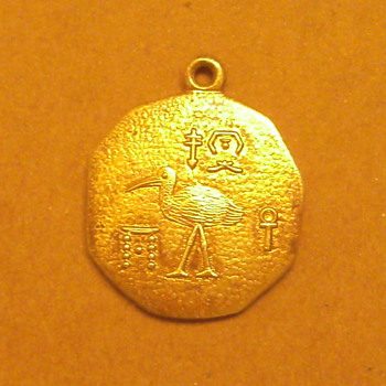 Gold Pendant w/unknown symbols