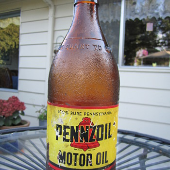 Amber glass bottle Pennzoil 10 weight oil .    1 quart  - Petroliana