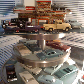 Yard sale table holds Promo Cars well! - Model Cars