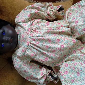 Black doll with blue eyes - Dolls