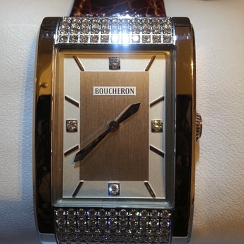 Boucheron 99 +4 diamond watch.