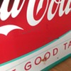 Fish tail coca cola signs