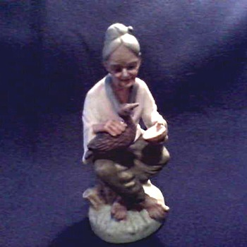 Napco (Japan) Hand Painted Figurine/ Farmer's Wife with Duck / Circa 20th Century