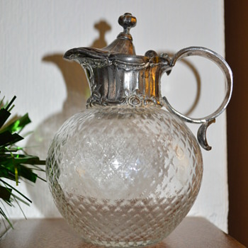Victorian glass jug with pewter top