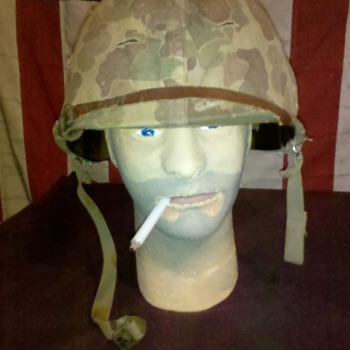 salty WWII US Marine combat helmet